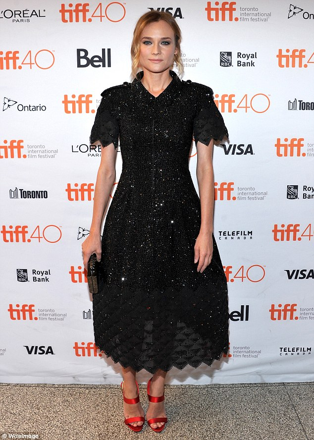 All that glitters: It was a busy few dats as Diane dazzled the crowd as she wore a black sequinned number and red shoes to the TIFF premiere of her new film Sky the previous day