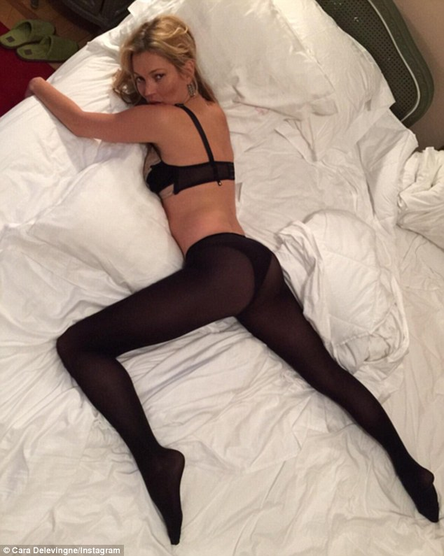Anything she can do! Kate showed Cara how it's done in this racy 'selfie swap', writhing around on bed in black lingerie and opaque tights