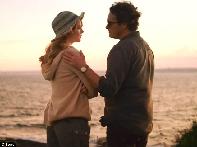 Sharing a moment: Joaquin Phoenix begins a life-changing relationship with one of his students - Emma Stone - in the upcoming Irrational Man, which just released its first trailer