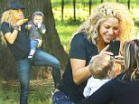EXCLUSIVE: Shakira spotted trying to keep her balance while carrying her son Sasha PiquÈ Mebarak and talking on her cellphone while they where in Central Park in New York City on Sep 23, 2015\n\nPictured: Shakira and Sasha PiquÈ Mebarak\nRef: SPL1135387  230915   EXCLUSIVE\nPicture by: Felipe Ramales / Splash News\n\nSplash News and Pictures\nLos Angeles: 310-821-2666\nNew York: 212-619-2666\nLondon: 870-934-2666\nphotodesk@splashnews.com\n