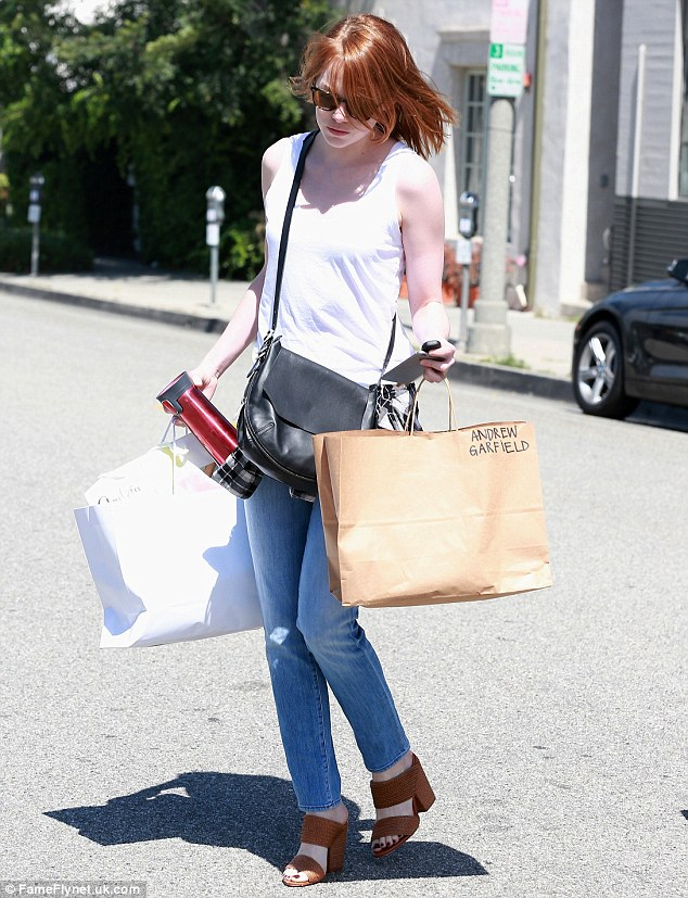 Quashing rumors? One of Emma's shopping bags was labeled 'Andrew Garfield,' the name of her rumored ex, that she reportedly split with after their three years together because the star 'had been in a dark place'