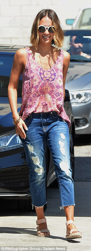 Showing it off:Highlighting her golden tan, Jessica wore a colourful loose pink patterned top which showed off her olive complexion along with distressed jeans