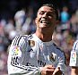 MADRID, SPAIN - APRIL 05:  Cristiano Ronaldo of Real Madrid CF celebrates after scoring his team's 4th goal during the La Liga match between Real Madrid CF and Granada CF at Estadio Santiago Bernabeu on April 5, 2015 in Madrid, Spain.  (Photo by Denis Doyle/Getty Images)