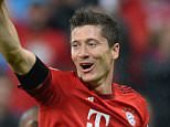 Bayern Munich's Polish striker Robert Lewandowski celebrates after his fifth goal for Munich during the German first division Bundesliga football match FC Bayern Muenchen vs VfL Wolfsburg in Munich, on September 22, 2015.    AFP PHOTO / CHRISTOF STACHE RESTRICTIONS: DURING MATCH TIME: DFL RULES TO LIMIT THE ONLINE USAGE TO 15 PICTURES PER MATCH AND FORBID IMAGE SEQUENCES TO SIMULATE VIDEO.  ==RESTRICTED TO EDITORIAL USE == FOR FURTHER QUERIES PLEASE  CONTACT THE  DFL DIRECTLY AT + 49 69 650050.CHRISTOF STACHE/AFP/Getty Images