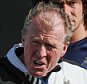 NEWCASTLE UPON TYNE, ENGLAND -  SEPTEMBER 22: Newcastle's Head Coach Steve McClaren (C) holds a ball under arm whilst pointing his hands and speaking to Yoan Gouffran (L) during a Newcastle United Training session at The Newcastle United Training Centre on September 22, 2015, in Newcastle upon Tyne, England. (Photo by Serena Taylor/Newcastle United via Getty Images)