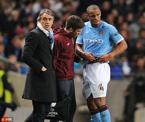 Substituted: Kompany (right) came off in the first-half against Aris