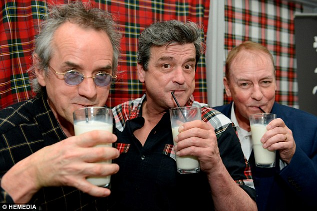 Cheers! The musicians sipped from glasses of milk - a reference to a rumour from their heyday that the three preferred it to alcohol