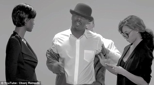 Raunchy: Kitted out in a grey suit and crisp white shirt, the 43-year-old star gets down and dirty as he raps about G-strings and his passionate sexual exploits in the black and white video