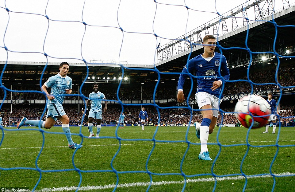 Despite having a relatively strong game at the back, Stones (right) can only pick the ball out of the back of the net