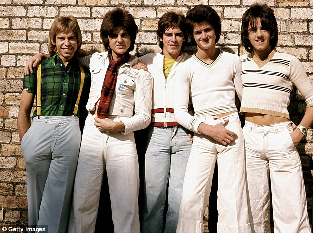 Back in the day: The full Bay City Rollers are pictured above in 1975 - only three of the former five-man-band are back for the tour. Pictured left to right are Derek Longmuir, Eric Faulkner, Alan Longmuir, Les Mckeown and Stuart Wood