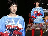 A model wears a creation for Moschino women's spring-summer 2016 collection, part of the Milan Fashion Week, unveiled in Milan, Italy, Thursday, Sept. 24, 2015. (AP Photo/Luca Bruno)