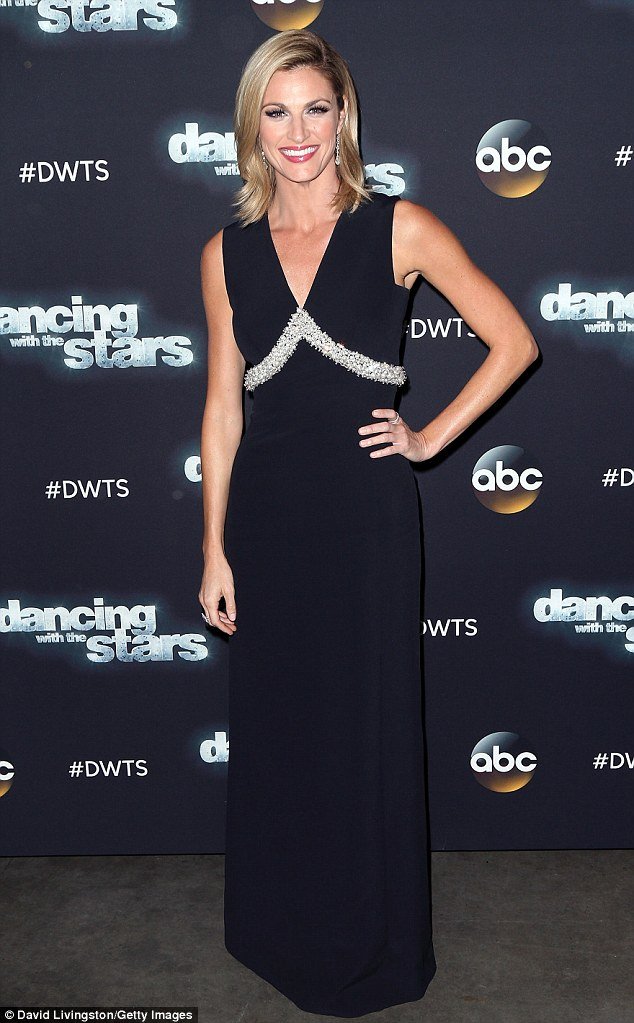 Keeping it simple: Floor-length was certainly the night's theme as DWTS host Erin Andrews also donned a black maxi-dress