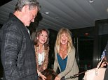 UK CLIENTS MUST CREDIT: AKM-GSI ONLY EXCLUSIVE: Beverly Hills, CA - Goldie Hawn and Kurt Russell seen leaving The Palm restaurant in Beverly Hills playing with a big dog.  Pictured: Goldie Hawn and Kurt Russell Ref: SPL1134935  220915   EXCLUSIVE Picture by: AKM-GSI / Splash News