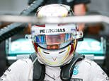 epa04948077 British Formula One driver Lewis Hamilton of Mercedes AMG GP prepares for the first practice session at the Suzuka Circuit in Suzuka, central Japan, 25 September 2015. The Japanese Formula One Grand Prix will be held on 27 September 2015.  EPA/DIEGO AZUBEL