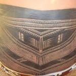 tatouage polynesien bas du dos samoan