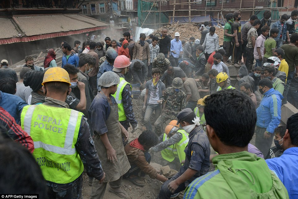 People clear rubble in Kathmandu's Durbar Square, a UNESCO World Heritage Site that was severely damaged by the earthquake