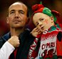 CARDIFF, WALES - SEPTEMBER 20: Wales fans look on during the 2015 Rugby World Cup Pool A match between Wales and Uruguay at the Millennium Stadium on September 20, 2015 in Cardiff, United Kingdom.  (Photo by Laurence Griffiths/Getty Images)