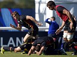 Wales' wing Hallam Amos (L) runs during a training session at the Hazelwood training centre in London on September 25, 2015 during the 2015 Rugby Union World Cup. Wales will face England on September 26. AFP PHOTO / FRANCK FIFE RESTRICTED TO EDITORIAL USEFRANCK FIFE/AFP/Getty Images