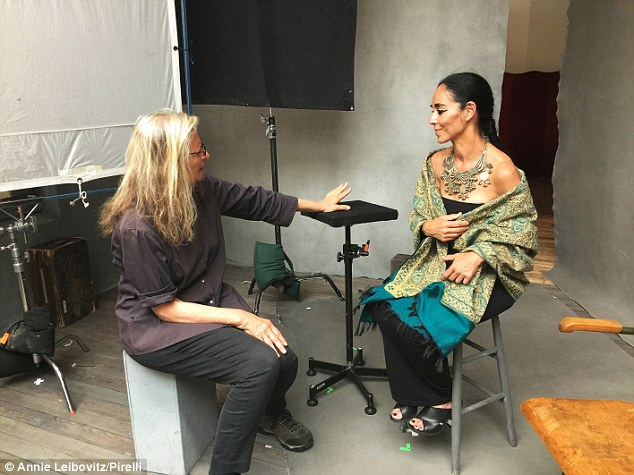 Taking direction: Iranian visual artistShirin Neshat can be seen talking to MsLeibovitz in between takes