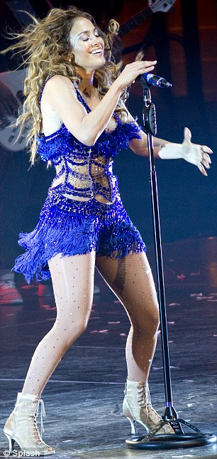 Blame it on Rio: The 42-year-old pop star's cobalt blue fringed dress, with over 500 crystals, was inspired by the carnivals of Brazil