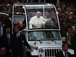 Pope Francis waves as he approaches St Patrick's Cathedral to lead evening prayers in New York on September 24, 2015. Pope Francis arrived in New York on the second leg of his US tour where he will address the UN General Assembly, visit the 9/11 Memorial and celebrate mass at Madison Square Garden. AFP PHOTO/JEWEL SAMADJEWEL SAMAD/AFP/Getty Images