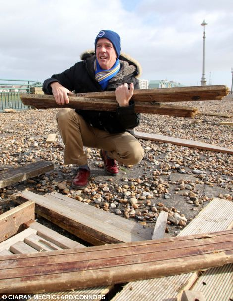 Norman Cook, the DJ known as Fatboy Slim, had to rescue the remains of his decking which was ripped from his home and dragged on to Hove seafront