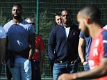 ST ALBANS, ENGLAND - SEPTEMBER 25:  Players and members of the French rugby team watch an Arsenal training session at London Colney on September 25, 2015 in St Albans, England.  (Photo by Stuart MacFarlane/Arsenal FC via Getty Images)