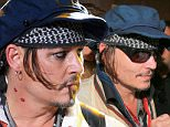 Rio de Janeiro, Brazil - Part 2 - After performing during Rock in Rio with his superband 'Hollywood Vampires' Johnny Depp and his pretty wife Amber Heard braved the crowd as they exited the venue. Depp waved to his fans and shared his unique style with our lenses.\nAKM-GSI         September  24, 2015\n \n To License These Photos, Please Contact :\n \n Steve Ginsburg\n (310) 505-8447\n (323) 423-9397\n steve@akmgsi.com\n sales@akmgsi.com\n \n or\n \n Maria Buda\n (917) 242-1505\n mbuda@akmgsi.com\n ginsburgspalyinc@gmail.com