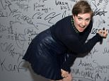Lena Dunham signs the wall at AOL Studios after participating in AOL's BUILD Speaker Series on Thursday, Sept. 24, 2015, in New York. (Photo by Charles Sykes/Invision/AP)