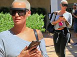 Amber Rose is spotted shopping in Beverly Hills, wearing an off-the-shoulder sweatshirt and workout pants. The only dash of color is her bright pink keychain. Friday, September 25, 2015  X17online.com