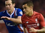 Carlisle United's English midfielder Luke Joyce (L) vies with Liverpool's Brazilian midfielder Philippe Coutinho during the English League Cup third round football match between Liverpool and Carlisle United at Anfield in Liverpool, north west England on September 23, 2015. The game finished 1-1. AFP PHOTO / PAUL ELLIS RESTRICTED TO EDITORIAL USE. No use with unauthorized audio, video, data, fixture lists, club/league logos or 'live' services. Online in-match use limited to 75 images, no video emulation. No use in betting, games or single club/league/player publications.PAUL ELLIS/AFP/Getty Images