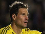 Chelsea's Bosnian goalkeeper Asmir Begovic gestures during the English League Cup third round football match between Walsall and Chelsea at The Banks's Stadium in Walsall, central England on September 23, 2015. Chelsea won the game 4-1. AFP PHOTO / LINDSEY PARNABY RESTRICTED TO EDITORIAL USE. No use with unauthorized audio, video, data, fixture lists, club/league logos or 'live' services. Online in-match use limited to 75 images, no video emulation. No use in betting, games or single club/league/player publications.LINDSEY PARNABY/AFP/Getty Images