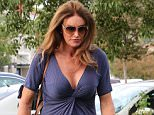Caitlyn Jenner grabs coffee with a much shorter man in Malibu. Cait wearing a low cut blue dress, heels and sunglasses. After getting coffee, Caitlyn goes to see a movie by herself  September 21, 2015 X17online.com