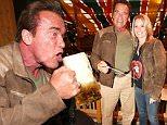 MUNICH, GERMANY - SEPTEMBER 24: Arnold Schwarzenegger and his partner Heather Milligan visit the Schuetzenfestzelt during the Oktoberfest 2015 at Theresienwiese on September 24, 2015 in Munich, Germany.  (Photo by Gisela Schober/Getty Images)