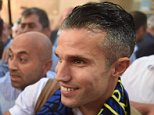 Manchester Uniteds international striker Robin Van Persie (R) gestures to fans as he arrives at the Sabiha Gokcen airport on July 12, 2015 in Istanbul. Turkish football giant Fenerbahce confirmed that Van Persie would arrive in Istanbul July 12 ahead of his eagerly-awaited transfer from Manchester United. AFP PHOTO/ OZAN KOSEOZAN KOSE/AFP/Getty Images