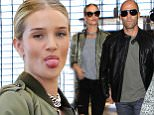 LOS ANGELES, CA, USA - SEPTEMBER 25: Model Rosie Huntington-Whiteley and actor/partner Jason Statham seen at LAX Airport on September 25, 2015 in Los Angeles, California, United States. (Photo by Image Press/Splash News)\n\nPictured: Rosie Huntington-Whiteley, Jason Statham\nRef: SPL1136642  250915  \nPicture by: Image Press / Splash News\n\nSplash News and Pictures\nLos Angeles: 310-821-2666\nNew York: 212-619-2666\nLondon: 870-934-2666\nphotodesk@splashnews.com\n