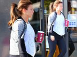 PREGNANT WAG COLEEN ROONEY SHOWING HER GROWING BABY BUMP AS SHE STOPS OFF FOR COFFEE IN WILMSLOW CHESHIRE