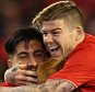 LIVERPOOL, ENGLAND - SEPTEMBER 23:  Adam Bogdan of Liverpool celebrates with Alberto Moreno and Emre Can after saving the crucial penalty from Bastien Hery of Carlisle United who looks on in the foreground during the Capital One Cup Third Round match between Liverpool and Carlisle United at Anfield on September 23, 2015 in Liverpool, England.  (Photo by Alex Livesey/Getty Images)