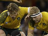 Fiji's Netani Talei is tackled by Australia's David Pocock, right, and Michael Hooper during the Rugby World Cup Pool A match between Australia and Fiji at the Millennium Stadium, Cardiff,  Wednesday, Sept. 23, 2015. (AP Photo/Matt Dunham)