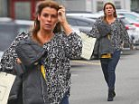 WAG COLEEN ROONEY HIDING HER GROWING BABY BUMP WITH SON KAIS COAT AS SHE ARRIVED AT OLD TRAFFORD TO WATCH HUSBAND WAYNE PLAY AGAINST SUNDERLAND