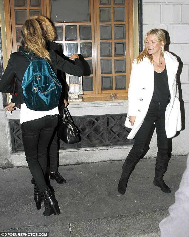 Off they go: Cara went back to her hotel in Milan, Kate hopped on a flight back to London