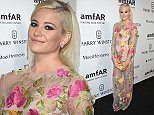 MILAN, ITALY - SEPTEMBER 26:  Pixie Lott arrives at amfAR Milano 2015 at La Permanente on September 26, 2015 in Milan, Italy.  (Photo by Venturelli/Getty Images for amfAR)