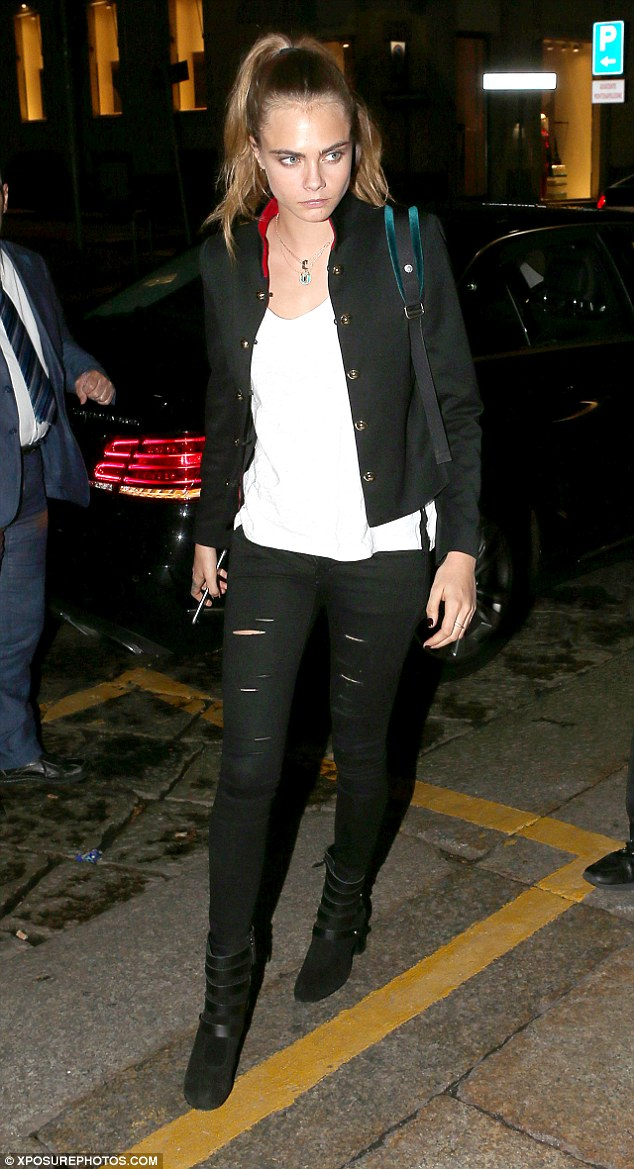 Laid-back: Cara, 23, flaunted her amazing model pins in skintight ripped skinny jeans, worn casually with a loose white t-shirt and jacket