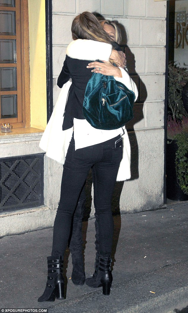 Embrace: They enveloped each other in an all-encompassing hug, while Cara kept on her teal velvet rucksack