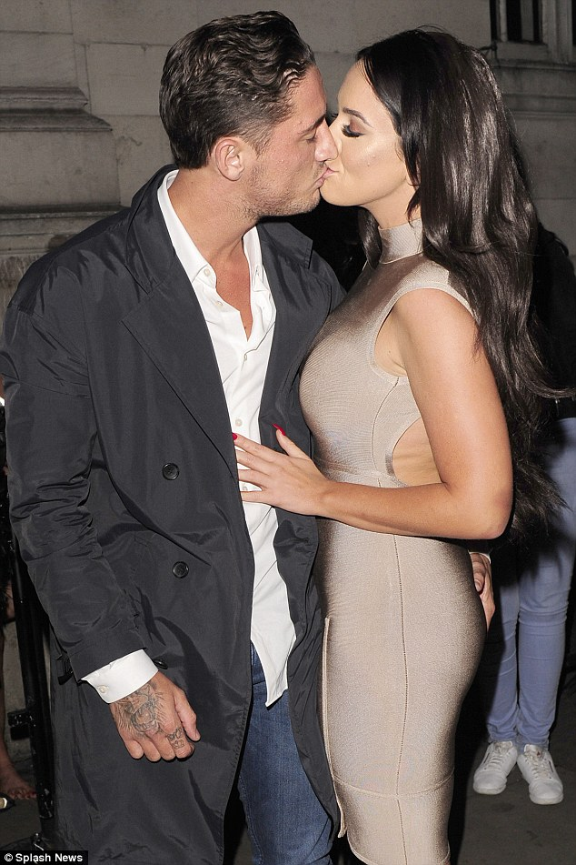 Mwah! Arriving at the venue with boyfriend Stephen Bear, she was out in force wearing a skin-tight dress in metallic taupe - and later kissed him for all to see