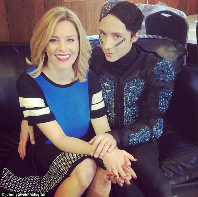 Matching in blue! Johnny Weir took a snap with Elizabeth Banks which he later posted on his Instagram account