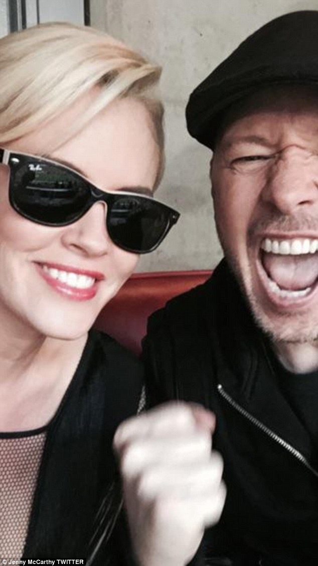 'Are you ready?!!!!!' Jenny McCarthy and husband Donnie Wahlberg get ready for the big game