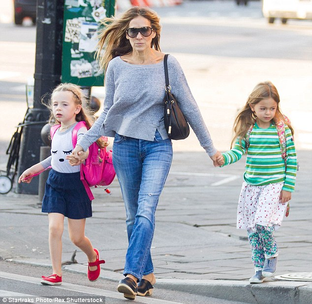 Safety first: The former Sex And The City star made sure to hold her little girls' hands as they crossed a road