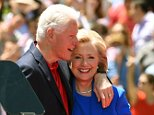 Former Secretary of State Hillary Clinton and Former US President Bill Clinton hug after she officially launched her campaign for the Democratic presidential nomination during a speech at the Franklin D. Roosevelt Four Freedoms Park on Roosevelt Island June 13, 2015 in New York. Hillary Clinton announced Saturday she was running for president for all Americans, unveiling a progressive platform promising to promote equal opportunity and fight for a beleaguered middle class. AFP PHOTO /  TIMOTHY  A. CLARY        (Photo credit should read TIMOTHY A. CLARY/AFP/Getty Images)