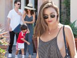September 26, 2015: Miranda Kerr enjoys a low-key Saturday afternoon with her son, Flynn Bloom, and beau, Snapchat CEO Evan Spiegel, at the Malibu Country Market in Malibu, California. The 32-year-old Australian model reveals a bit too much as she goes bra-less in a gray jumpsuit, while son Flynn is wearing his red soccer jersey as they stop for some frozen treats at a gelato shop. \nPictured here: Miranda Kerr, Flynn Bloom\nMandatory Credit: INFphoto.com\nRef: infusla-257/277/302